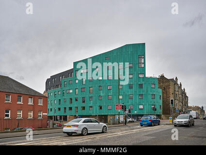 An interestingly designed and Colured Apartment Bock Complex next to a busy Edinburgh Road brightens up an overcast day. Edinburgh, Scotland. - Stock Photo