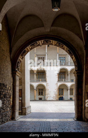 Krakow, Poland - August 13, 2017: beautiful architectural arch and a view of the columns of the royal palace in the castle of Wawel