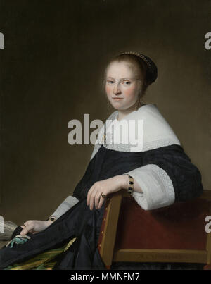 . Portrait of Maria van Strijp (1627-1707), wife of Eduard Wallis. At knee-length, sitting on a chair, facing left, her face turned to the viewer. She is holding a fan in her right hand. Pendant of File:Jan Verspronck - Portret van Eduard Wallis (1621-1684), 1652.jpg.  Portrait of Maria Strijp. 1652. Johannes Verspronck.Portret van Maria Strijp - Stock Photo