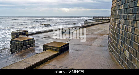 Waves breaking against the sea defences in Scarborough's South Bay. - Stock Photo
