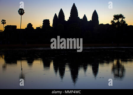Towers of the main temple complex of Angkor Wat at sunrise, Siem Reap, Cambodia - Stock Photo