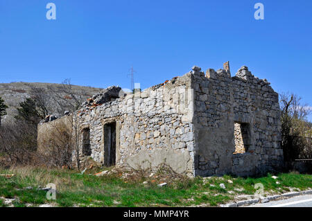House in ruins by road E71, Gracac, Croatia - Stock Photo