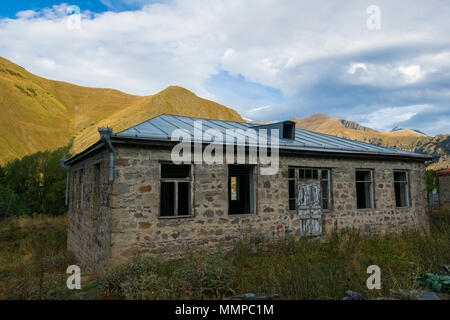 old destroyed house. Photo was taken in the georgian town Stepantsminda. - Stock Photo