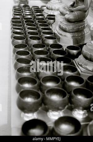 Buddhist alms bowls at Wat Intharam Worawihan in Wong Wian Yai Thonburi in Bangkok in Thailand in Southeast Asia Far East. Buddhism Religion Travel - Stock Photo