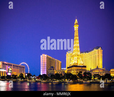 LAS VEGAS, NEVADA - MAY 17, 2017: Beautiful night scene of Paris Las Vegas Resort across water with other hotels and casinos in view. - Stock Photo