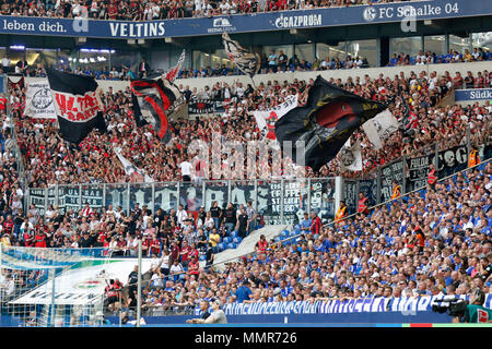 sports, football, Bundesliga, 2017/2018, FC Schalke 04 vs Eintracht Frankfurt 1:0, Veltins Arena Gelsenkirchen, fun and enthusiasm at the Frankfurt football fans, flag waving - Stock Photo