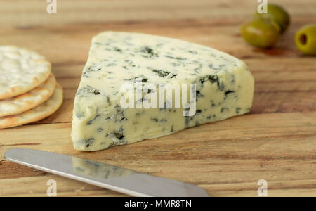 Blue veined cheese on wooden board - Stock Photo