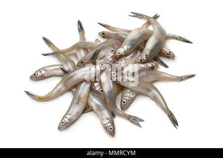 Heap of fresh raw smelt fishes isolated on white background - Stock Photo