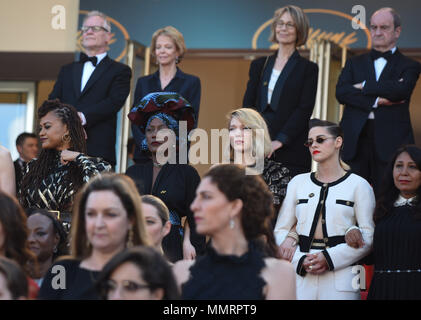 May 12, 2018 - Cannes, France: Kirsten Stewart, Lea Seydoux, Khadja Nin gather on the red carpet steps among 82 women working in the film industry to protest of the lack of female filmmakers honored throughout the history of the festival before the 'Girls of The Sun' premiere during the 71st Cannes film festival. Credit: Idealink Photography/Alamy Live News - Stock Photo