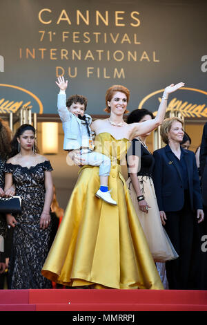 Cannes, France. 12th May, 2018. French director Eva Husson (front) poses on the red carpet during the premiere of the film 'Girls of the Sun' at the 71st Cannes International Film Festival in Cannes, France, on May 12, 2018. The 71st Cannes International Film Festival is held here from May 8 to May 19. Credit: Chen Yichen/Xinhua/Alamy Live News - Stock Photo
