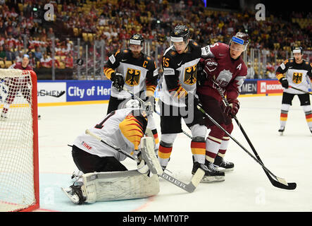 Herning, Denmark.. 12th May, 2018. (LR) Dennis Seidenberg, Niklas Treutle, Frederik Tiffels of Team Germany and Andris Dzerins of Team Latvia during the match between Latvia and Germany on 12.05.2018 in Herning, Denmark. (Photo by Marco Leipold/City-Press GbR) | usage worldwide Credit: dpa picture alliance/Alamy Live News - Stock Photo