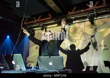 Leeds, UK. 12th May 2018. Wolfgang Flur, former member of German electronic band Kraftwerk performs a set at the Brudenell Social Club, Leeds, UK. In the background are projected images of Kraftwerk members. Credit: John Bentley/Alamy Live News - Stock Photo