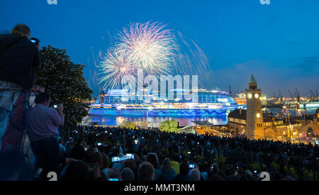 12 May 2018, Germany, Hamburg: People watch fireworks over cruise ship 'Aida Perla' to celebrate the 829th 'Harbour birthday' event in Hamburg. Photo: Daniel Bockwoldt/dpa Credit: dpa picture alliance/Alamy Live News - Stock Photo