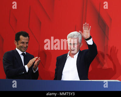 HANDOUT - 12 May 2018, Germany, Munich: Jupp Heynckes (R), coach of FC Bayern Munich, and sporting director Hasan Salihamidzic celebrate winning the championship together with the fans at the Paulaner beer garden at the Nockherberg. Earlier though, a home defeat dampened the joy over the 28th championship title. Photo: Adam Pretty/FCB/Getty Images /dpa - ATTENTION: editorial use only and only if the credit mentioned above is referenced in full Credit: dpa picture alliance/Alamy Live News - Stock Photo