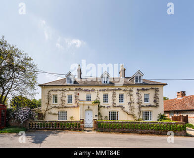 Large elegant country house in East Stratton, a pretty small village near Winchester in Hampshire, southern England on a sunny spring day, blue sky - Stock Photo