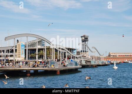 The Rambla del Mar floating footbridge at Port Vell in Barcelona, Spain on April 15, 2018. The bridge was opened in 1994. - Stock Photo