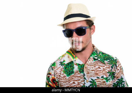 Studio shot of young handsome tourist man wearing sunglasses iso - Stock Photo