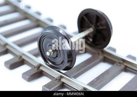 Train toy wheels. Train model wheels. Train wagon miniature model wheels. Train wheels on a railway. - Stock Photo