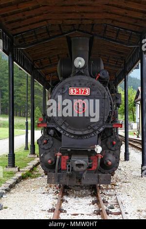 Old steam powered locomotive. Vintage steam train locomotive. Black restored vintage locomotive. - Stock Photo