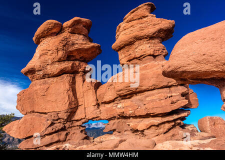 MARCH 8, 2017 - SIAMESE TWINS RED ROCKS AT GARDEN OF THE GODS SHOW PIKES PEAK VIEW, COLOARDO SPRINGS, CO, USA - a National Natural Landmark showing Sedimentary red rock formations - Stock Photo
