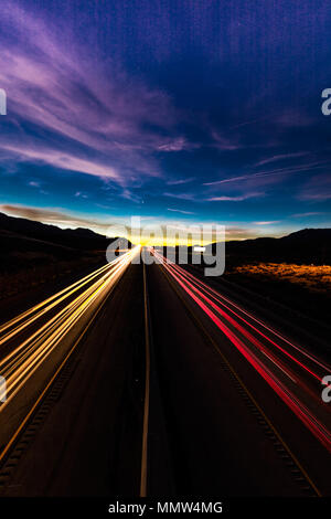 MARCH 12, 2017, LAS VEGAS, NV - streaked lights at sunset over Interstate 15, south of Las Vegas, Nevada at sunset - Stock Photo