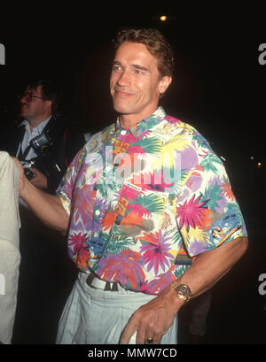WEST HOLLYWOOD, CA - JULY 13: Actor Arnold Schwarzenegger attends Milton Berle's 82nd birthday party at The Improv on July 13, 1990 in West Hollywood, California. Photo by Barry King/Alamy Stock Photo - Stock Photo