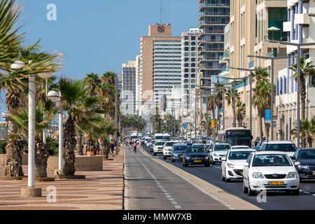 View of traffic flow on city road along modern hotel buildings and promenade in Tel Aviv, Israel. - Stock Photo
