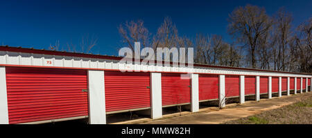 MARCH 6, 2018 - Self storage warehouse with open red doors outside Marshall - Texas Americana - Stock Photo