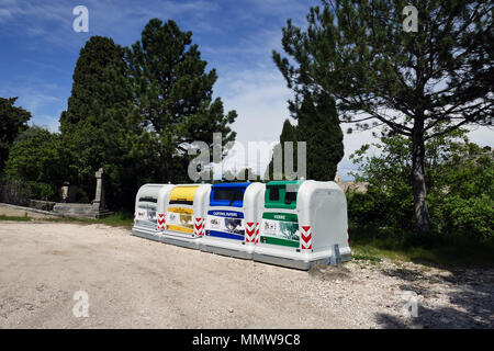 Large coloured recycling bins for glass paper and packaging Recycling bins in a row, lined up, Orgon, France, - Stock Photo