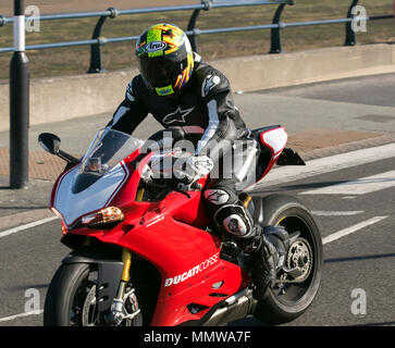 Ducati Panigale R Motorcycle being ridden on Marine Drive, Southport, UK - Stock Photo