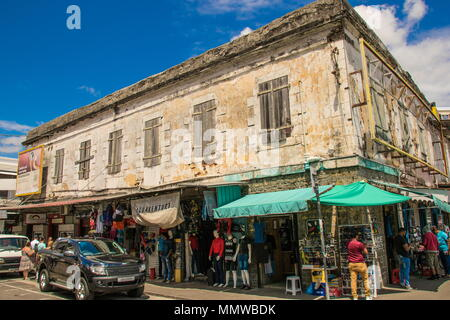 Port Louis, Mauritius - unidentified tourists flock to the old Central Market in the city to experience local culture and tradition - Stock Photo