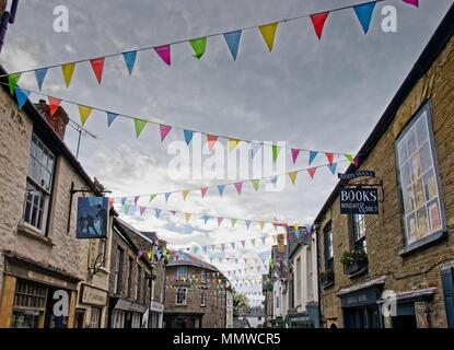 Literary Festival bunting across the street in Hay-on-Wye, Powys, Wales - Stock Photo