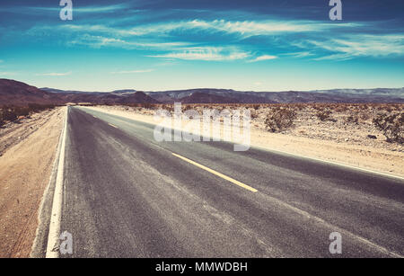 Empty desert road, color toning applied, travel concept picture. - Stock Photo