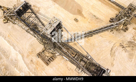 Aerial view  of coal mine Giant excavator in Germany Havy Industry - Stock Photo