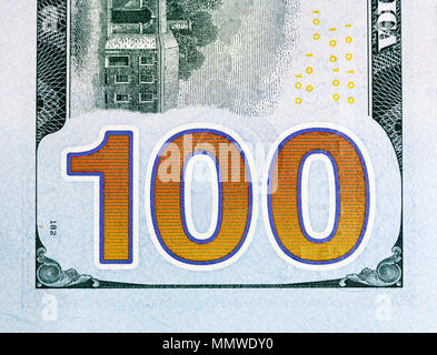 Number 100. Hundred dollars bill fragment closw-up, new edition. - Stock Photo