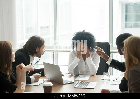 Upset african businesswoman suffering from discrimination or exh - Stock Photo