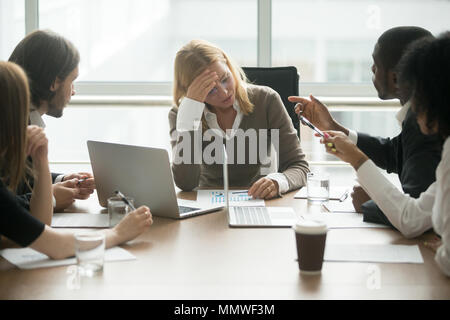 Stressed businesswoman feeling tired suffering from disrespect a - Stock Photo
