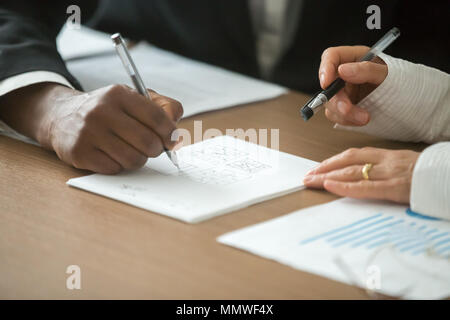 Diverse business partners playing tic-tac-toe game at office des - Stock Photo