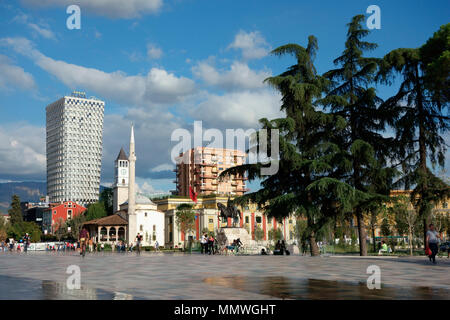 The Skanderbeg Monument and Et'hem Bey Mosque on Skanderbeg Square in Tirana, Albania, Balkans - Stock Photo
