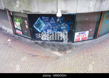 Shuttered up shop units in a walkway in Birmingham city centre, West Midlands, UK - Stock Photo