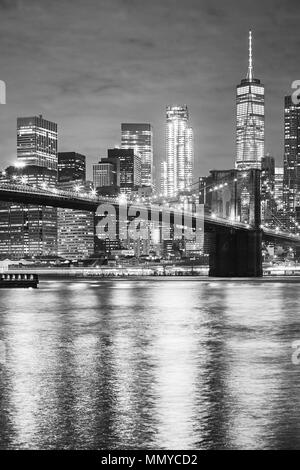 Black and white picture of the Brooklyn Bridge and Manhattan at night, New York City, USA. - Stock Photo