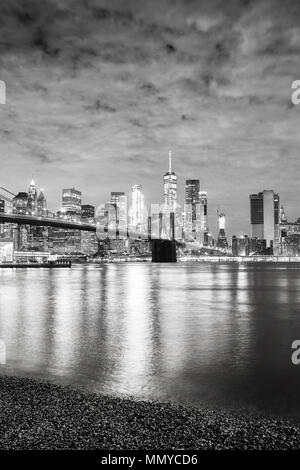 Black and white picture of Manhattan waterfront at night, New York City, USA. - Stock Photo
