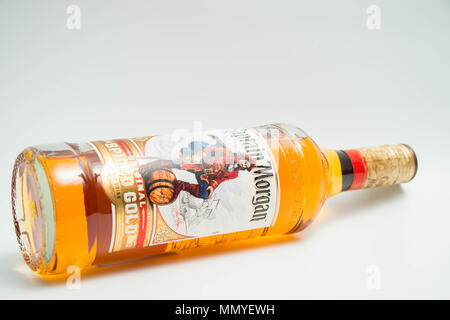 New Bottle of Captain Morgan Spiced Rum isolated on white - Stock Photo