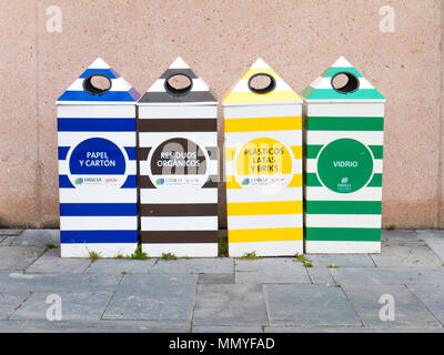 GIJON, SPAIN - April 01, 2018:  Separate paper, plastic, glass and organic garbage collection bins in the form of beach cabins in the Atlantico botani - Stock Photo