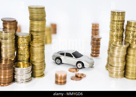 Abstract photo of car price rising. Car model isolated on white background with a lot of euro coins. - Stock Photo