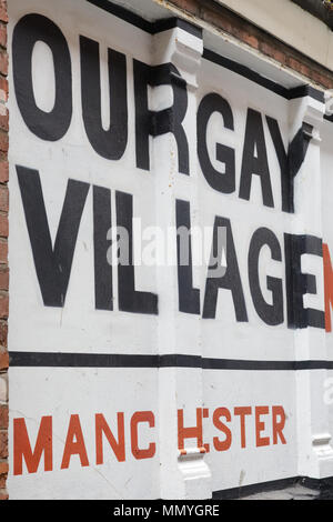 Our Gay village Manchester, painted on a wall - Stock Photo