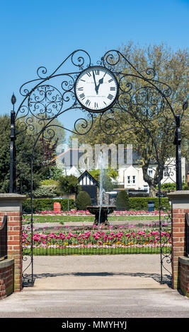 Prittlewell Square entrance gateway clock and flower garden. - Stock Photo