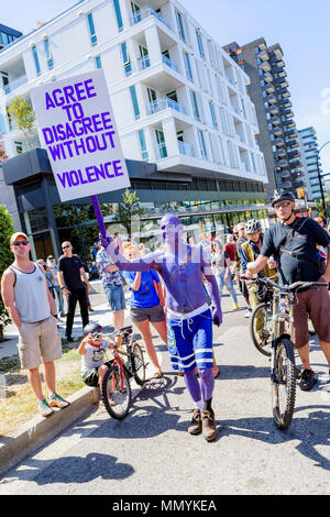 Purple man at Anti-Racism Rally, City Hall, Vancouver, British Columbia, Canada. - Stock Photo