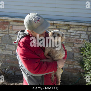 Smiling man holding Yorkshire Terrier dog, Canis lupus familiaris - Stock Photo