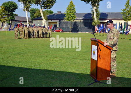 U. S. Army Lt. Col. Brian J. Bender, Outgoing Commander U.S. Army Health Clinic Vicenza, speaks during the Change of Command Ceremony at Caserma C. Ederle in Vicenza, Italy, August 1, 2017. (U.S. Army Photo by Visual Information Specialist Paolo Bovo/Released) - Stock Photo